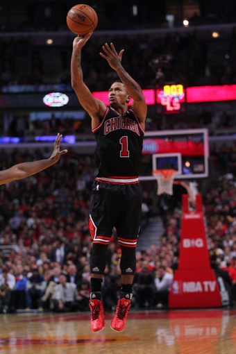 Oct 31, 2013; Chicago, IL, USA; Chicago Bulls point guard Derrick Rose (1) takes a shot during the second half against the New York Knicks at the United Center. Chicago won 82-81. Mandatory Credit: Dennis Wierzbicki-USA TODAY Sports