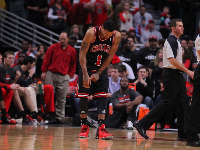 Oct 31, 2013; Chicago, IL, USA; Chicago Bulls point guard Derrick Rose (1) reacts during the second half against the New York Knicks at the United Center. Chicago won 82-81. Mandatory Credit: Dennis Wierzbicki-USA TODAY Sports