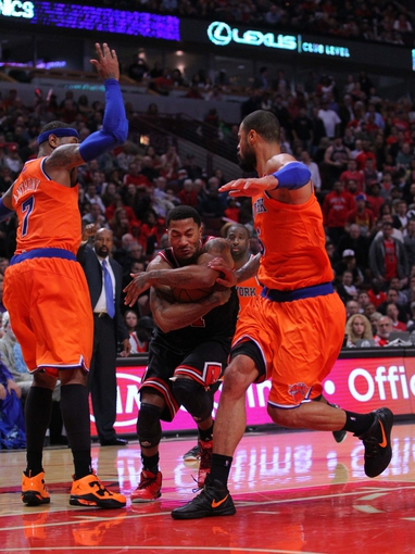 Oct 31, 2013; Chicago, IL, USA; Chicago Bulls point guard Derrick Rose (center) drives between New York Knicks small forward Carmelo Anthony (left) and center Tyson Chandler (right) during the second half at the United Center. Chicago won 82-81. Mandatory Credit: Dennis Wierzbicki-USA TODAY Sports