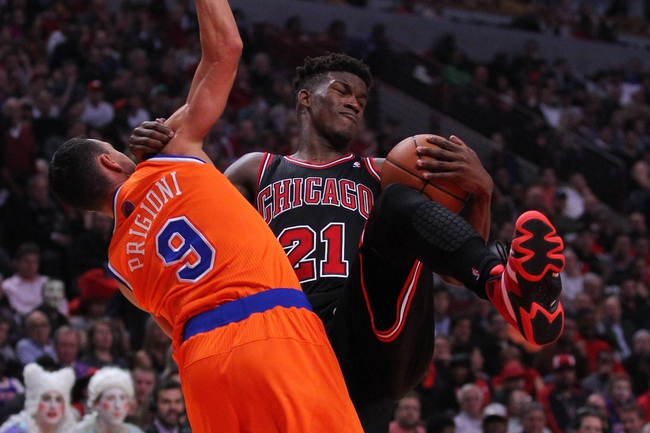 Oct 31, 2013; Chicago, IL, USA; Chicago Bulls shooting guard Jimmy Butler (21) is fouled by New York Knicks point guard Pablo Prigioni (9) during the second half at the United Center. Chicago won 82-81. Mandatory Credit: Dennis Wierzbicki-USA TODAY Sports