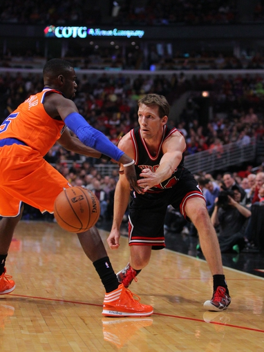 Oct 31, 2013; Chicago, IL, USA; Chicago Bulls small forward Mike Dunleavy (34) passes around New York Knicks shooting guard Tim Hardaway Jr. (5) during the second half at the United Center. Chicago won 82-81. Mandatory Credit: Dennis Wierzbicki-USA TODAY Sports