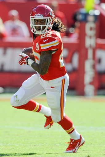 Oct 27, 2013; Kansas City, MO, USA; Kansas City Chiefs wide receiver Dexter McCluster (22) catches a pass and runs for yardage during the first half of the game against the Cleveland Browns at Arrowhead Stadium. Mandatory Credit: Denny Medley-USA TODAY Sports