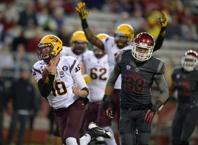 Oct 31, 2013; Pullman, WA, USA; Arizona State Sun Devils quarterback Taylor Kelly (10) is pursued by Washington State Cougars linebacker Tana Pritchard (33) on a 6-yard touchdown run in the first quarter at Martin Stadium. Mandatory Credit: Kirby Lee-USA TODAY Sports
