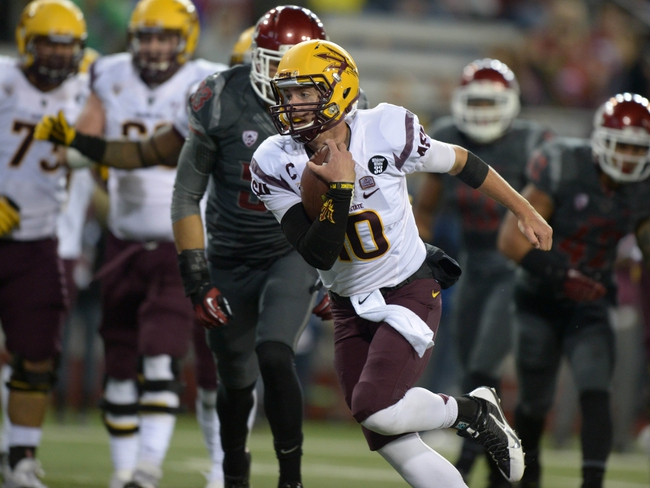 Oct 31, 2013; Pullman, WA, USA; Arizona State Sun Devils quarterback Taylor Kelly (10) scores on a 6-yard touchdown run in the first quarter against the Washington State Cougars at Martin Stadium. Mandatory Credit: Kirby Lee-USA TODAY Sports
