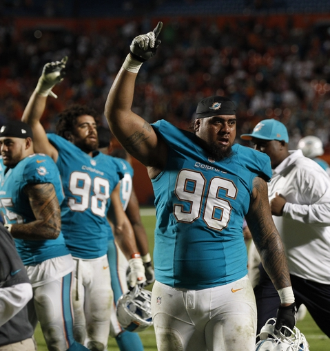 Oct 31, 2013; Miami Gardens, FL, USA; Miami Dolphins defensive tackle Paul Soliai (96) and defensive tackle Jared Odrick (98) celebrate defeating the Cincinnati Bengals in overtime 22-20 at Sun Life Stadium. Mandatory Credit: Robert Mayer-USA TODAY Sports