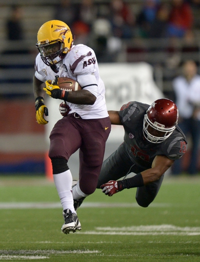 Oct 31, 2013; Pullman, WA, USA; Arizona State Sun Devils tailback Marion Grice (1) is defended by Washington State Cougars linebacker Darryl Monroe (13) at Martin Stadium. Mandatory Credit: Kirby Lee-USA TODAY Sports