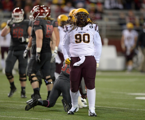 Oct 31, 2013; Pullman, WA, USA; Arizona State Sun Devils defensive tackle Will Sutton (90) celebrates after tackling Washington State Cougars running back Marcus Mason (35) at Martin Stadium. Mandatory Credit: Kirby Lee-USA TODAY Sports