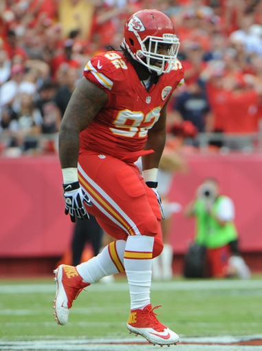 Sep 15, 2013; Kansas City, MO, USA; Kansas City Chiefs nose tackle Dontari Poe (92) during the game against the Dallas Cowboys at Arrowhead Stadium. Mandatory Credit: John Rieger-USA TODAY Sports