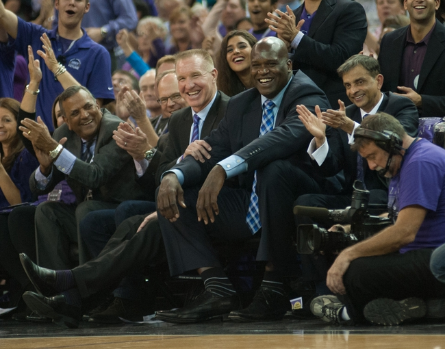 Oct 30, 2013; Sacramento, CA, USA; Sacramento Kings advisor Chris Mullin and owner Shaquille O'Neal and owner Vivek Ranadive applaud the on court entertainment during a timeout at Sleep Train Arena. Mandatory Credit: Ed Szczepanski-USA TODAY Sports