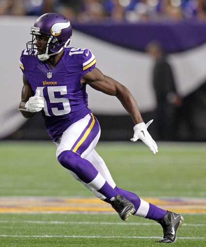 Aug 9, 2013; Minneapolis, MN, USA; Minnesota Vikings wide receiver Greg Jennings (15) runs a route during the first quarter against the Houston Texans at the Metrodome. Mandatory Credit: Brace Hemmelgarn-USA TODAY Sports