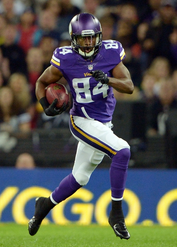 Sep 29, 2013; London, UNITED KINGDOM; Minnesota Vikings receiver Cordarrelle Patterson (84) carries the ball on a kickoff return in the NFL International Series game at Wembley Stadium. The Vikings defeated the Steelers 34-27. Mandatory Credit: Kirby Lee-USA TODAY Sports