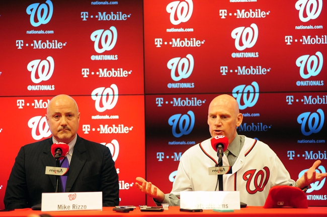 Nov 1, 2013; Washington, DC, USA; Washington Nationals general manager Mike Rizzo (left) and manager Matt Williams (right) talk to the media during the press conference at Nationals Park. Mandatory Credit: Evan Habeeb-USA TODAY Sports