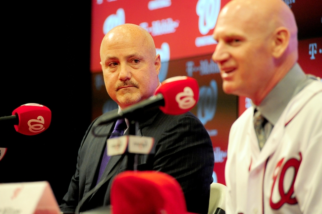 Nov 1, 2013; Washington, DC, USA; Washington Nationals general manager Mike Rizzo (left) watches as manager Matt Williams (right) talks to the media during the press conference at Nationals Park. Mandatory Credit: Evan Habeeb-USA TODAY Sports