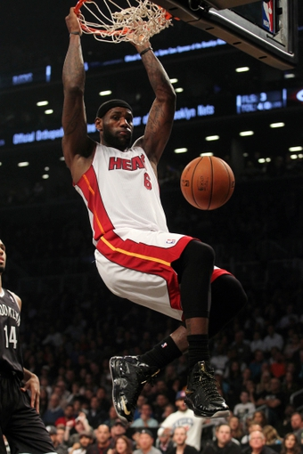 Nov 1, 2013; Brooklyn, NY, USA; Miami Heat small forward LeBron James (6) dunks against the Brooklyn Nets during the second quarter of a game at Barclays Center. Mandatory Credit: Brad Penner-USA TODAY Sports