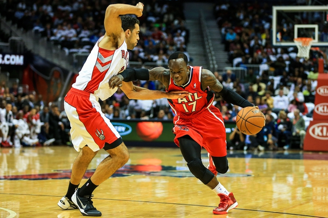 Nov 1, 2013; Atlanta, GA, USA; Atlanta Hawks point guard Dennis Schroder (17) drives to the basket past Toronto Raptors small forward Landry Fields (2) in the second half at Philips Arena. The Hawks won 102-95. Mandatory Credit: Daniel Shirey-USA TODAY Sports