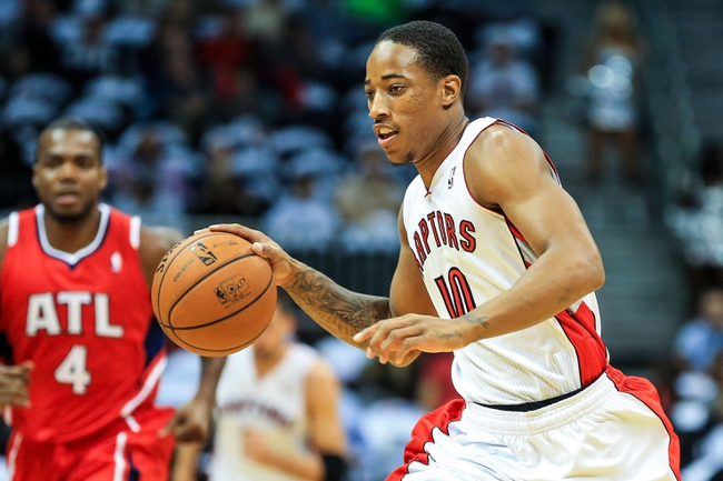 Nov 1, 2013; Atlanta, GA, USA; Toronto Raptors shooting guard DeMar DeRozan (10) runs towards the basket in a fast transition in the first quarter against the Atlanta Hawks at Philips Arena. Mandatory Credit: Daniel Shirey-USA TODAY Sports