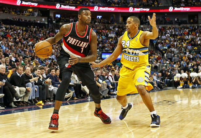 Nov 1, 2013; Denver, CO, USA; Denver Nuggets point guard Andre Miller (24) guards Portland Trail Blazers small forward Dorell Wright (1) in the second quarter at the Pepsi Center. Mandatory Credit: Isaiah J. Downing-USA TODAY Sports