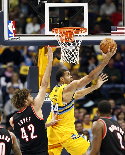 Nov 1, 2013; Denver, CO, USA; Portland Trail Blazers center Robin Lopez (42) guards Denver Nuggets center JaVale McGee (34) in the second quarter at the Pepsi Center. Mandatory Credit: Isaiah J. Downing-USA TODAY Sports