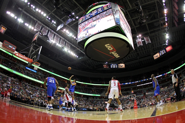 Nov 1, 2013; Washington, DC, USA; Philadelphia 76ers point guard Michael Carter-Williams (1) shoots the ball over Washington Wizards power forward Trevor Booker (35) in the fourth quarter at Verizon Center. The 76ers won 109-102. Mandatory Credit: Geoff Burke-USA TODAY Sports