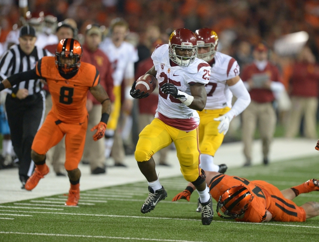 Nov 1, 2013; Corvallis, OR, USA; Southern California Trojans tailback Silas Redd (25) carries the ball against the Oregon State Beavers at Reser Stadium. Mandatory Credit: Kirby Lee-USA TODAY Sports