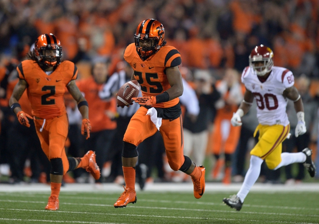 Nov 1, 2013; Corvallis, OR, USA; Oregon State Beavers safety Ryan Murphy (25) scores on a 41-yard interception return in the second quarter against the Southern California Trojans at Reser Stadium. Mandatory Credit: Kirby Lee-USA TODAY Sports
