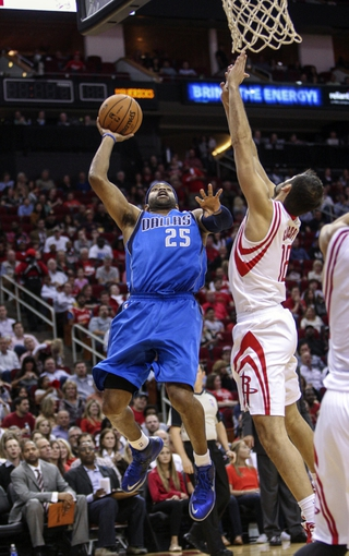 Nov 1, 2013; Houston, TX, USA; Dallas Mavericks shooting guard Vince Carter (25) shoots during the fourth quarter as Houston Rockets small forward Omri Casspi (18) defends at Toyota Center. Mandatory Credit: Troy Taormina-USA TODAY Sports
