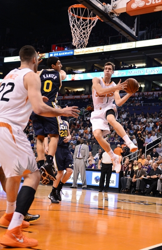 Nov 1, 2013; Phoenix, AZ, USA; Phoenix Suns guard Goran Dragic (1) makes a pass in traffic against the Utah Jazz in the first half at US Airways Center. Mandatory Credit: Jennifer Stewart-USA TODAY Sports