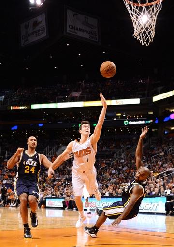 Nov 1, 2013; Phoenix, AZ, USA; Phoenix Suns guard Goran Dragic (1) commits an offensive foul against the Utah Jazz guard John Lucas III (5) in the first half at US Airways Center. Mandatory Credit: Jennifer Stewart-USA TODAY Sports