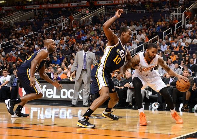Nov 1, 2013; Phoenix, AZ, USA; Phoenix Suns forward Marcus Morris (15) handles the ball against the Utah Jazz guard Alec Burks (10) in the first half at US Airways Center. Mandatory Credit: Jennifer Stewart-USA TODAY Sports