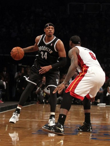 Nov 1, 2013; Brooklyn, NY, USA; Brooklyn Nets small forward Paul Pierce (34) controls the ball against Miami Heat small forward LeBron James (6) during the third quarter of a game at Barclays Center. Mandatory Credit: Brad Penner-USA TODAY Sports