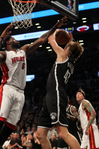 Nov 1, 2013; Brooklyn, NY, USA; Brooklyn Nets small forward Andrei Kirilenko (47) is fouled by Miami Heat small forward LeBron James (6) during the third quarter of a game at Barclays Center. Mandatory Credit: Brad Penner-USA TODAY Sports
