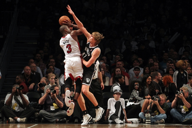 Nov 1, 2013; Brooklyn, NY, USA; Miami Heat shooting guard Dwyane Wade (3) is fouled by Brooklyn Nets small forward Andrei Kirilenko (47) during the fourth quarter of a game at Barclays Center. Mandatory Credit: Brad Penner-USA TODAY Sports