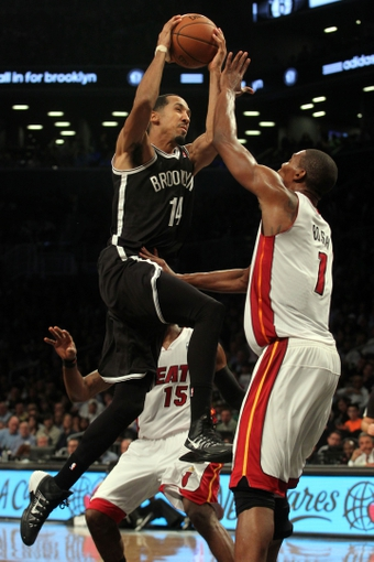 Nov 1, 2013; Brooklyn, NY, USA; Brooklyn Nets point guard Shaun Livingston (14) drives to the basket on Miami Heat center Chris Bosh (1) during the fourth quarter of a game at Barclays Center. Mandatory Credit: Brad Penner-USA TODAY Sports