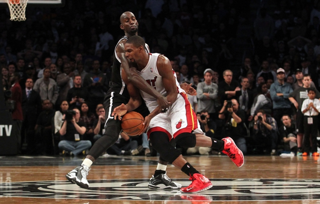 Nov 1, 2013; Brooklyn, NY, USA; Miami Heat center Chris Bosh (1) is fouled by Brooklyn Nets power forward Kevin Garnett (2) during the fourth quarter of a game at Barclays Center. Mandatory Credit: Brad Penner-USA TODAY Sports