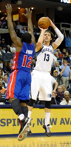 Nov 1, 2013; Memphis, TN, USA; Memphis Grizzlies small forward Mike Miller (13) shoots the ball against Detroit Pistons point guard Will Bynum (12) during the second half at FedExForum. Memphis Grizzlies beat the Detroit Pistons 111 to 108. Mandatory Credit: Justin Ford-USA TODAY Sports