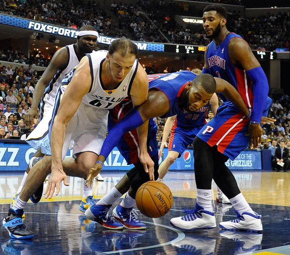 Nov 1, 2013; Memphis, TN, USA; Memphis Grizzlies center Kosta Koufos (41) and Detroit Pistons center Greg Monroe (10) fight for the ball during the second half at FedExForum. Memphis Grizzlies beat the Detroit Pistons 111 to 108. Mandatory Credit: Justin Ford-USA TODAY Sports