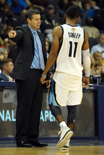 Nov 1, 2013; Memphis, TN, USA; Memphis Grizzlies head coach David Joerger talks to Memphis Grizzlies point guard Mike Conley (11) during a time out against Detroit Pistons during the second half at FedExForum. Memphis Grizzlies beat the Detroit Pistons 111 to 108. Mandatory Credit: Justin Ford-USA TODAY Sports