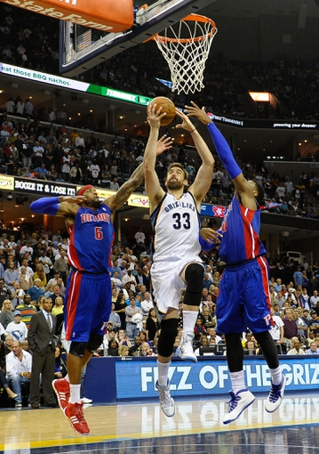 Nov 1, 2013; Memphis, TN, USA; Memphis Grizzlies center Marc Gasol (33) lays the ball up against Detroit Pistons small forward Josh Smith (6) during the second half at FedExForum. Memphis Grizzlies beat the Detroit Pistons 111 to 108. Mandatory Credit: Justin Ford-USA TODAY Sports