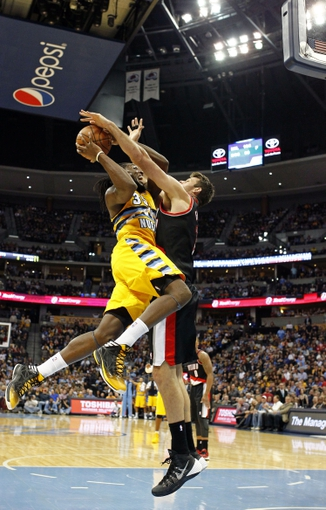Nov 1, 2013; Denver, CO, USA; Portland Trail Blazers power forward Joel Freeland (19) guards Denver Nuggets small forward Kenneth Faried (35) in the fourth quarter at the Pepsi Center. The Trail Blazers won 113-98. Mandatory Credit: Isaiah J. Downing-USA TODAY Sports