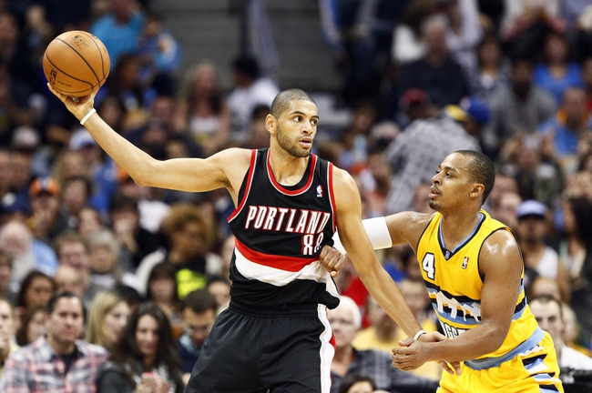 Nov 1, 2013; Denver, CO, USA; Portland Trail Blazers small forward Nicolas Batum (88) keeps the ball from Denver Nuggets point guard Randy Foye (4) in the third quarter at the Pepsi Center. The Trail Blazers won 113-98. Mandatory Credit: Isaiah J. Downing-USA TODAY Sports