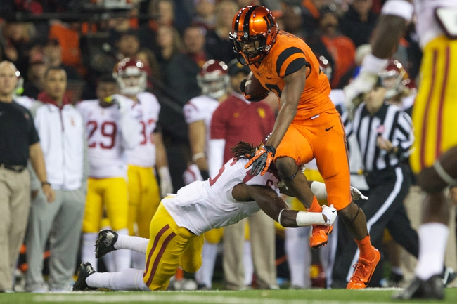 Nov 1, 2013; Corvallis, OR, USA; USC Trojans safety Josh Shaw (6) grabs the legs of Oregon State Beavers wide receiver Brandin Cooks (7) in the second half at Reser Stadium. Mandatory Credit: Jaime Valdez-USA TODAY Sports