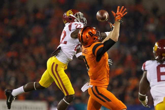 Nov 1, 2013; Corvallis, OR, USA;  USC Trojans safety Leon McQuay III (22) prevents Oregon State Beavers wide receiver Richard Mullaney (8) from catching the ball in the second half at Reser Stadium. Mandatory Credit: Jaime Valdez-USA TODAY Sports