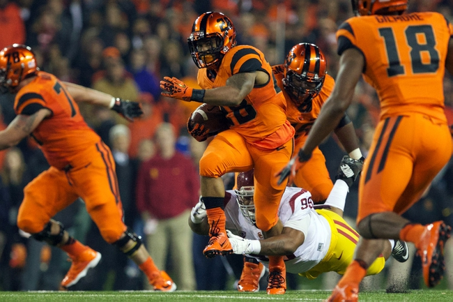 Nov 1, 2013; Corvallis, OR, USA;  Oregon State Beavers running back Terron Ward (28) runs through the arms of USC Trojans defensive tackle Joey Augello (96) in the second half at Reser Stadium. Mandatory Credit: Jaime Valdez-USA TODAY Sports