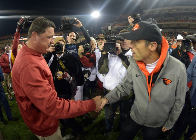 Nov 1, 2013; Corvallis, OR, USA; Southern California Trojans coach Ed Orgeron (left) shakes hands with Oregon State Beavers coach Mike Riley after the game at Reser Stadium. USC defeated Oregon State 31-14.  Mandatory Credit: Kirby Lee-USA TODAY Sports