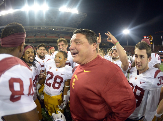 Nov 1, 2013; Corvallis, OR, USA; Southern California Trojans coach Ed Orgeron celebrates with players after the game against the Oregon State Beavers at Reser Stadium. USC defeated Oregon State 31-14.  Mandatory Credit: Kirby Lee-USA TODAY Sports