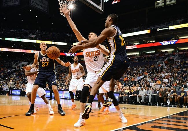 Nov 1, 2013; Phoenix, AZ, USA; Utah Jazz guard Alec Burks (10) makes a pass against the Phoenix Suns center Alex Len (21) in the second half at US Airways Center.  The Suns defeated the Jazz 87-84. Mandatory Credit: Jennifer Stewart-USA TODAY Sports