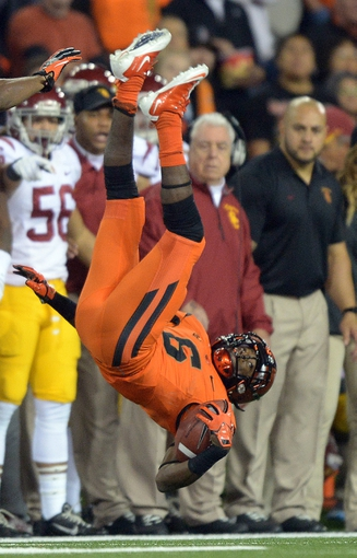 Nov 1, 2013; Corvallis, OR, USA; Oregon State Beavers receiver Victor Bolden (6) is upended on a kickoff return against the Southern California Trojans at Reser Stadium. USC defeated Oregon State 31-14.  Mandatory Credit: Kirby Lee-USA TODAY Sports