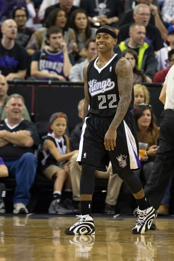 Nov 1, 2013; Sacramento, CA, USA; Sacramento Kings point guard Isaiah Thomas (22) smiles after being called for a foul against the Los Angeles Clippers during the third quarter at Sleep Train Arena. The Los Angeles Clippers defeated the Sacramento Kings 110-101. Mandatory Credit: Kelley L Cox-USA TODAY Sports