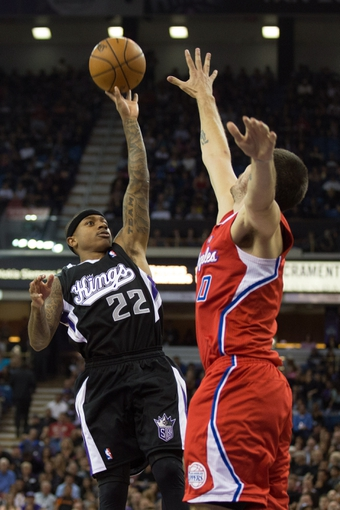 Nov 1, 2013; Sacramento, CA, USA; Sacramento Kings point guard Isaiah Thomas (22) shoots the ball against Los Angeles Clippers center Byron Mullens (0) during the third quarter at Sleep Train Arena. The Los Angeles Clippers defeated the Sacramento Kings 110-101. Mandatory Credit: Kelley L Cox-USA TODAY Sports