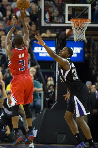 Nov 1, 2013; Sacramento, CA, USA; Los Angeles Clippers point guard Chris Paul (3) scores a basket against Sacramento Kings power forward Jason Thompson (34) during the fourth quarter at Sleep Train Arena. The Los Angeles Clippers defeated the Sacramento Kings 110-101. Mandatory Credit: Kelley L Cox-USA TODAY Sports